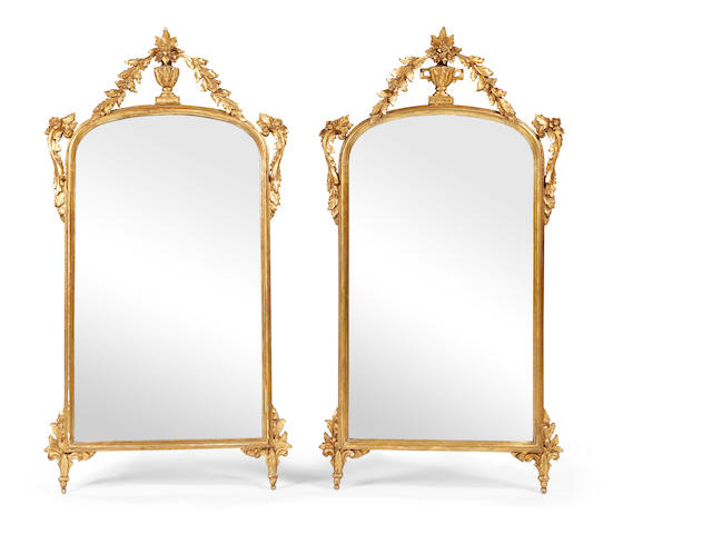 A pair of late 18th century-style giltwood and composition pier mirrors