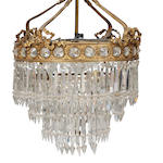 An early 20th century gilt metal and cut glass four-light chandelierFitted for electricity