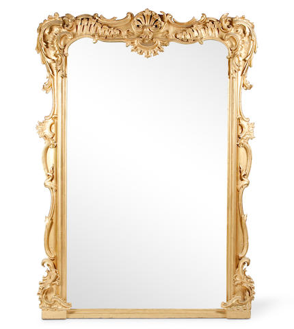 A large giltwood and composition wall mirror