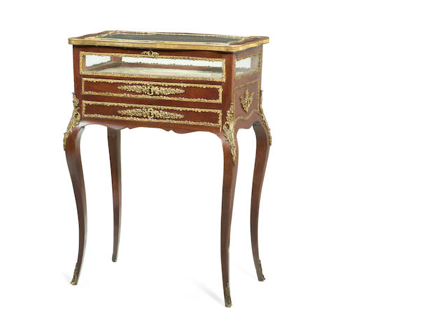 A French late 19th century gilt metal mounted mahogany bijouterie table in the Louis XV style