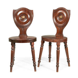 A pair of Regency mahogany hall chairs