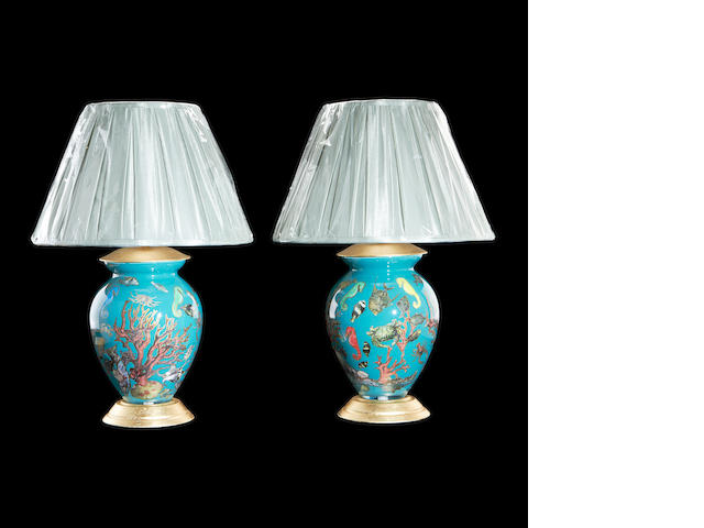 A pair of hand blown glass lamp bases decoarted with coral designs, shells and sea horses together with two shades