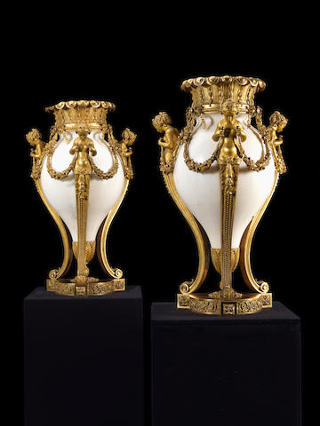 An impressive pair of French 19th century ormolu-mounted white marble vases