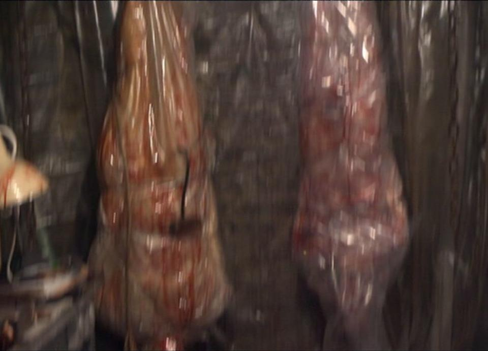 Torchwood, Series 1 - Countrycide: A scale prop corpse model, with a slit-throat rolled in plastic sheeting, 2006,