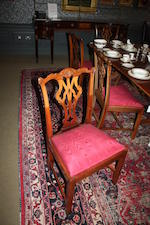 A set of ten 20th century walnut dining chairs