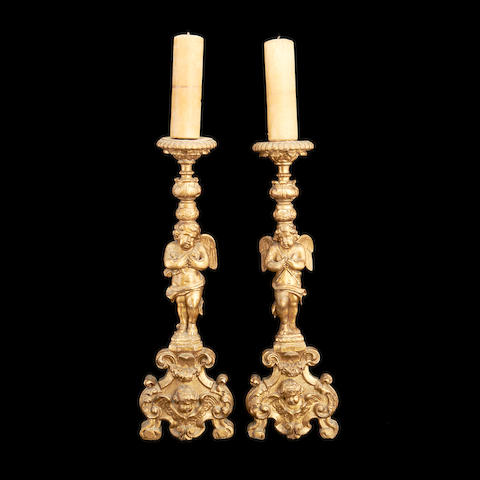 A pair of Italian Baroque 18th century giltwood candlesticks