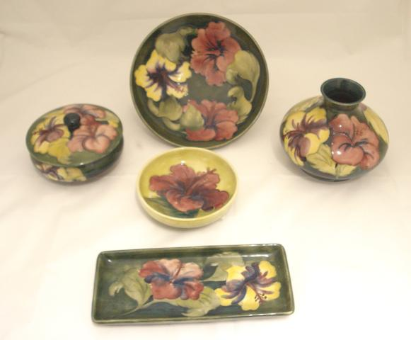 A collection of Walter Moorcroft 'Hibiscus' pattern pottery