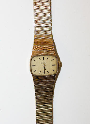 Omega:  a lady's 9ct gold wrist watch, the rounded rectangular dial with baton numerals, to a flexible 9ct gold strap.