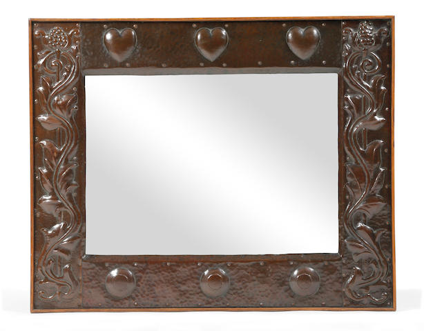 An Arts & Crafts hammered copper wall mirror, circa 1900