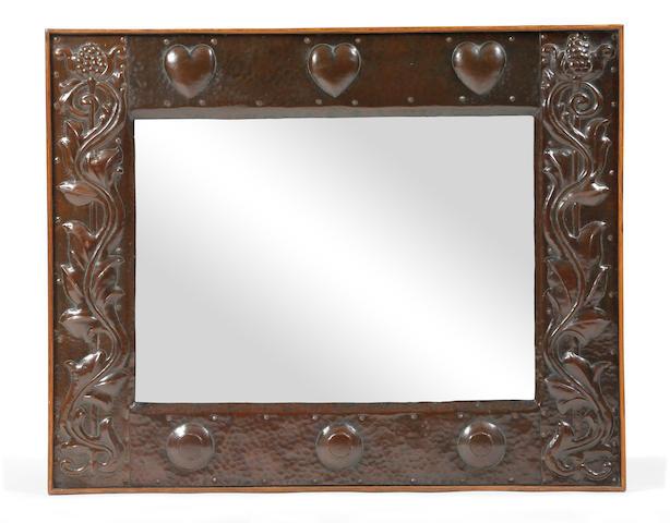 An Arts & Crafts hammered copper wall mirror, circa 1900