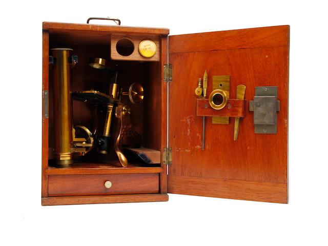 A mid 20th century brass monocular microscope  Redfern's, Sheffield,