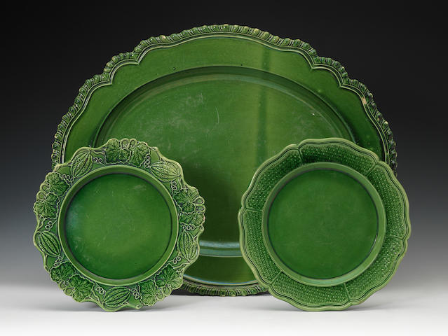 Four green glazed plates and one platter