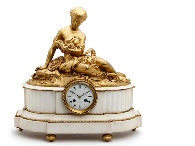 A 19th century French figural gilt metal and white marble mantel clock  Raingo Freres, Paris