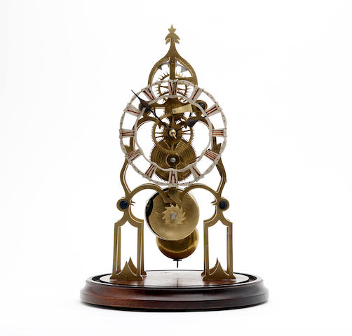 A mid 19th century style Gothic brass skeleton clock Anonymous