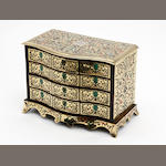 A rosewood, tortoiseshell and brass miniature serpentine-fronted commode, French, early 20th century