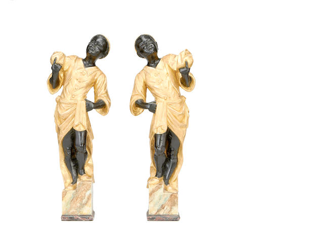 A pair of Venetian style painted and gilt decorated blackamoor figures