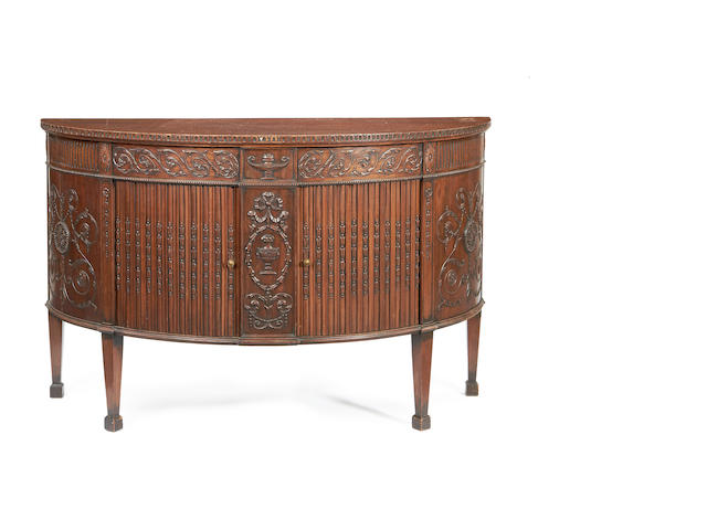 An Edwardian mahogany demi lune side cabinet in the Adam revival style