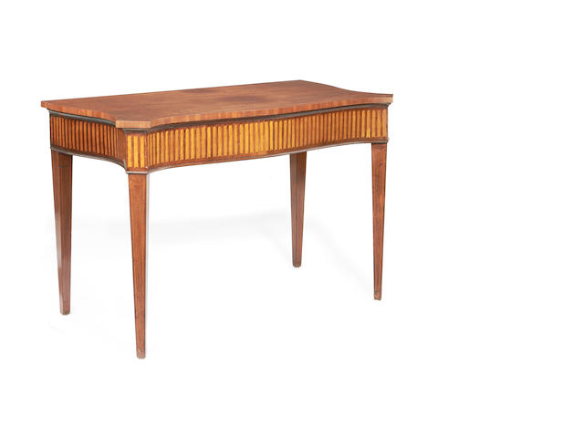 A George III mahogany and satinwood inlaid serpentine serving table
