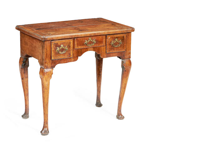 A George II walnut and crossbanded lowboy