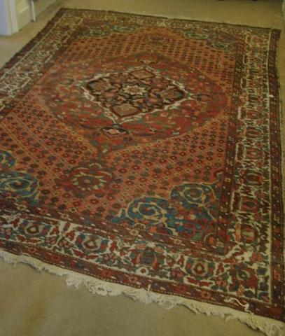 A Bakhtiar carpet, the pink field with a large central floral medallion, 3.15 x 2.1m.
