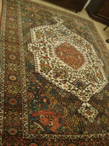 A Bakhtiar carpet, the floral field enclosing a large serrated edge white ground medallion with central hexagonal medallion,3.1 x 2.27m