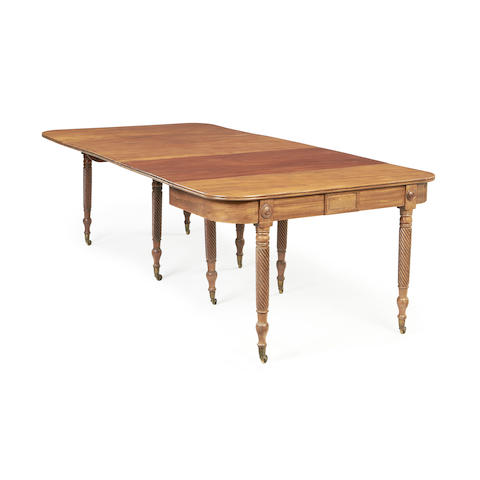 A Regency mahogany concertina action extending dining table  in the manner of Wilkinson of Moorfields,