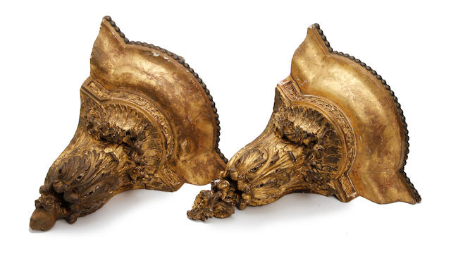 A pair of late 19th century carved giltwood corner wall brackets