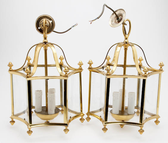 A pair of 20th century brass and glass hall lanterns