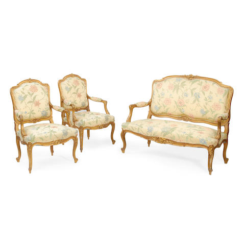 A three piece suite of French late 19th/early 20th century giltwood  salon furniture in the Louis XV style