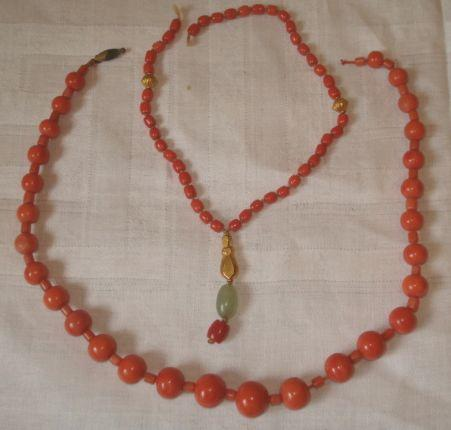 Two strings of coral beads