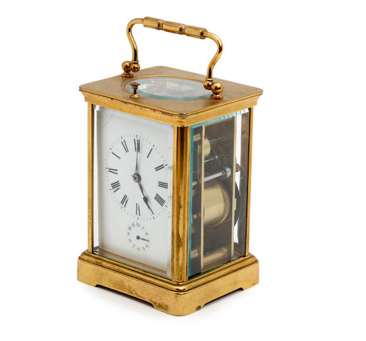 A late 19th century French gilt brass carriage clock with repeat and alarm Anonymous
