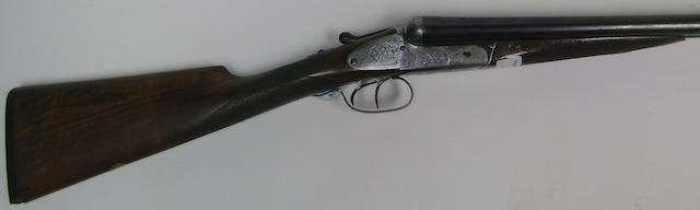 A 12-bore assisted-opening side-plated boxlock ejector gun by Cogswell & Harrison, no. 48843 In a brass-mounted leather case