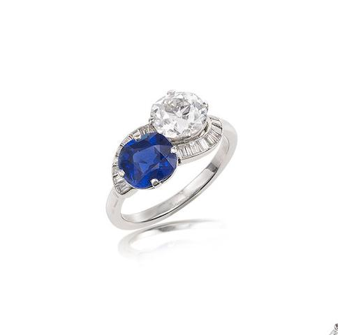 A sapphire and diamond cross-over ring,