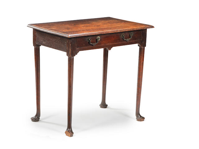 An 18th century oak side table, lacking part of one foot