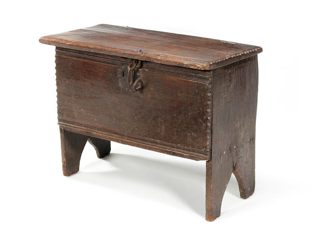A 17th century small oak boarded chest