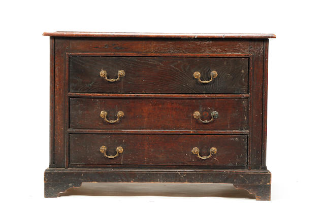 An early 18th century and later oak chest of drawers