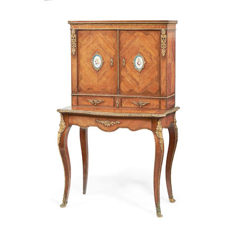 A French 19th century gilt metal and porcelain mounted tulipwood and rosewood bonheur du jour in the Louis XV style
