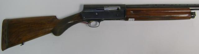 A 12-bore (2¾in) 'Light Twelve' self-loading gun by F.N., no. 410119 With removable magazine restrictor