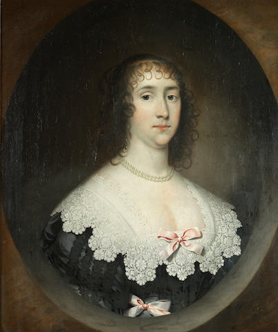 Cornelis Jonson van Ceulen (London 1593-1661 Utrecht) Portrait of a lady, bust-length, in a black dress with a white lace collar, within a painted oval