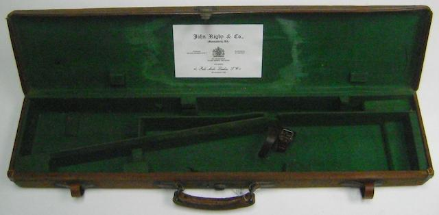 A canvas take-down rifle-case with J. Rigby & Co. trade-label