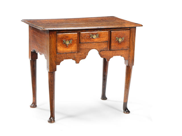 An oak lowboy Mid-18th century and later