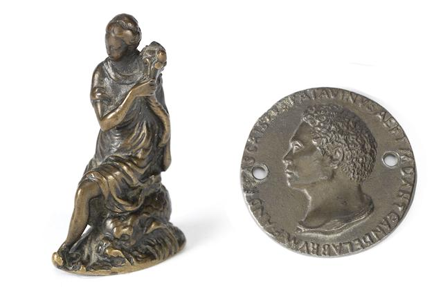 A North Italian 16th century patinated bronze figure of Venus on a dolphin together with a 19th century bronze medal after Andrea Riccio