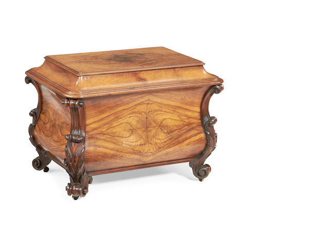 An early Victorian walnut bombé cellarette in the Rococo revival style
