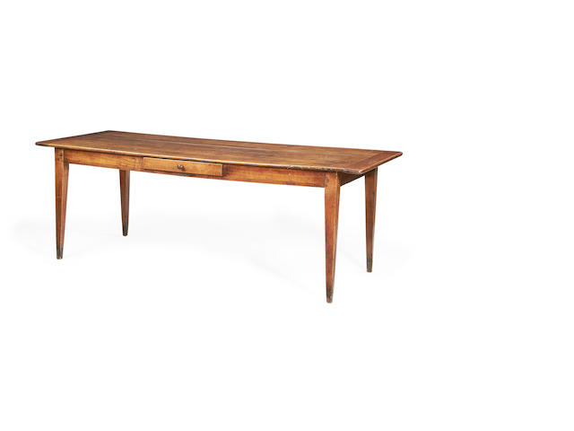 A French late 19th century cherrywood and walnut farmhouse dining table