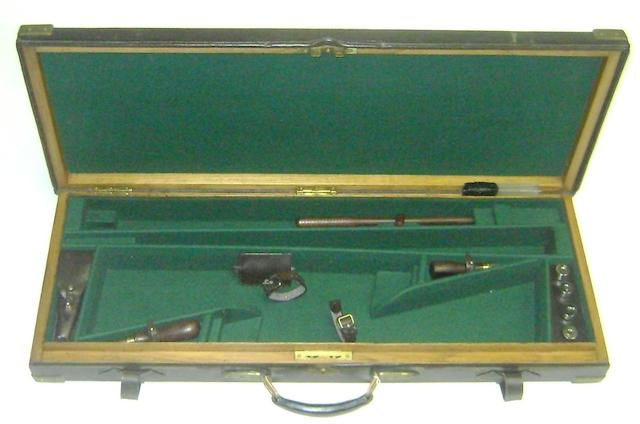A brass-mounted oak and leather double-guncase