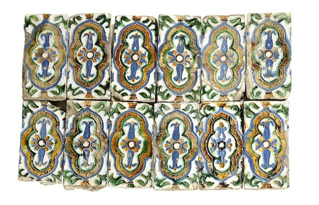 A panel of twelve Spanish (Seville) arista glazed pottery tiles, circa 1525-50