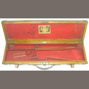 A brass-mounted oak and leather single-guncase