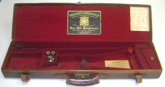 A Holland & Holland leather single-guncase