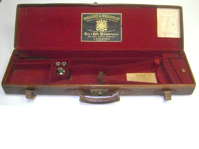 A Holland & Holland leather single-guncase