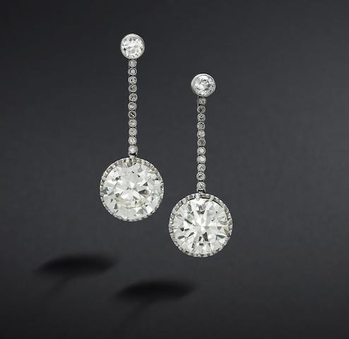 A pair of diamond pendent earrings/rings (3)